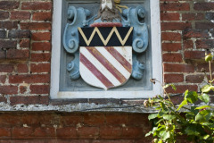 Family crest on the exterior of Rothamsted Manor, an event and filming location in Harpenden, Hertfordshire
