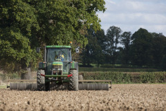 Tractor harvesting crops at Rothamsted Farm, Harpenden Hertfordshire
