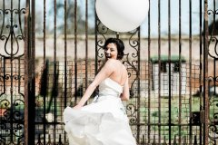 Bride with balloon at Rothamsted Manor © Weddingly