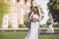 wedding couple standing outside Rothamsted Manor near St Albans