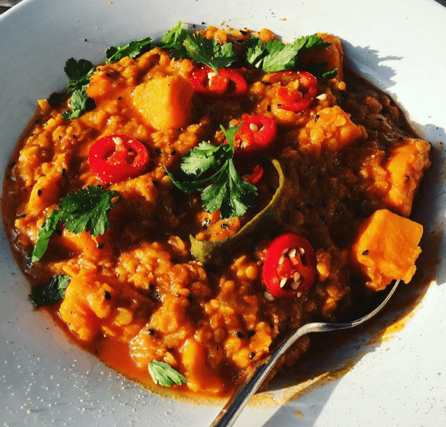 Pumpkin, red lentil and tomato stew